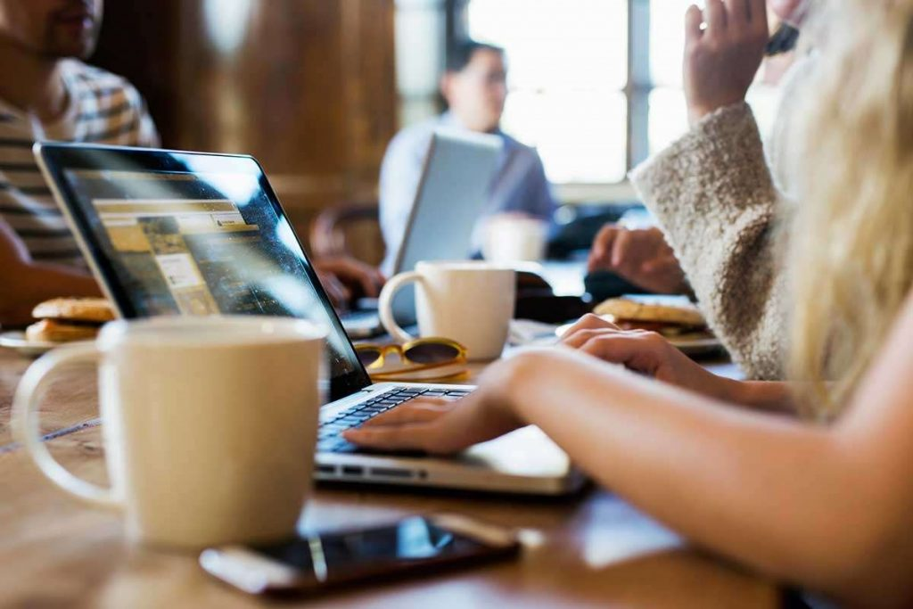 Image of people working at coffee shop